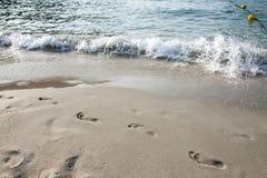 Voetstappen in het zand royalty-vrije stock foto