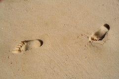 Voetstappen op zand Stock Fotografie
