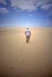 Voetstappen op zand Stock Foto's
