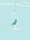Vogel in kooi stock illustratie