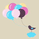 Vogel mit Ballonen Stockfotografie