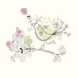 Vogel mit Blumen Stockfoto