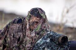 Vogelfotograaf in Camouflage stock foto's