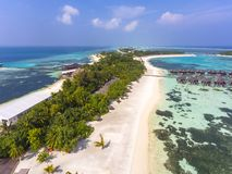 Vogelperspektive auf Sonnenuntergang in Olhuveli-Insel, Malediven lizenzfreies stockbild