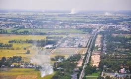 Vogelperspektive von Feldern des ungeschälten Reises in der Mekong-Delta lizenzfreies stockfoto