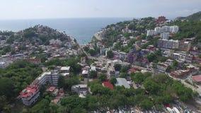 Vogelperspektive von Häusern, Häuser und Hotels in Los Cabos setzen auf den Strand stock video footage