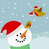 Vogels en sneeuwman met de hoeden van de Kerstman Royalty-vrije Stock Afbeeldingen