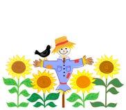 Vogelscheuche und Sonnenblumen Stockfotos