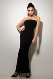 Vogue. Beautiful woman posing in black dress Royalty Free Stock Image