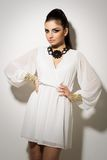 Vogue. Beautiful woman posing in white dress Royalty Free Stock Photography
