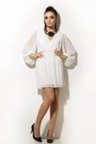 Vogue. Beautiful woman posing in white dress Royalty Free Stock Photos
