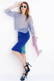 Vogue fashion model woman posing in blue skirt on Royalty Free Stock Photos