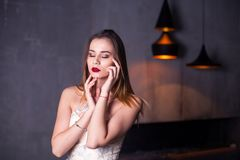 Vogue fashion style portrait of young beautiful pretty elegant rich woman wearing evening dress. Girl closed her eyes Stock Photos