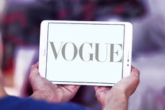 Vogue logo. Logo of fashion company, vogue on samsung tablet Royalty Free Stock Photography