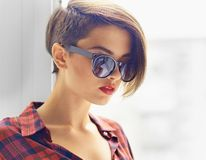 Vogue look. Close-up image of a gorgeous young woman wearing stylish sunglasses Royalty Free Stock Photo