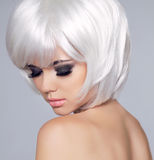 Vogue Style Beauty Fashion Girl Model Portrait. Eye makeup. Hair Stock Photography