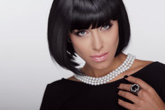 Vogue style. Fashion Haircut. Hairstyle.. Sexy Lady. Stylish Fringe. Short Hair Style. Brunette woman with jewelry pearls Stock Photos