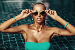 Vogue style fashion portrait of beautiful chic woman in water.  royalty free stock image