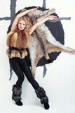 Vogue style photo of young girl in a fur coat. Vogue style photo of young girl in a foxy fur coat Royalty Free Stock Photography