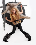 Vogue style photo of young girl in a fur coat Stock Photography