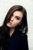Vogue style portrait of beautiful brunette woman stock photo