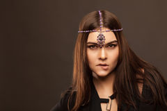 vogue style portrait of beautiful brunette woman with hair ornament stock images