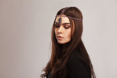 vogue style portrait of beautiful brunette woman with hair ornament royalty free stock photos