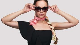 Vogue style portrait of beautiful delicate woman. Wearing sunglasses Royalty Free Stock Photos