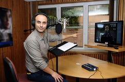 Voice Actor in Recording Studio. Portuguese actor Rui Unas in studio, giving voice to Cole Freeman, one of the characters in the new exclusive PlayStation 3 Royalty Free Stock Photo