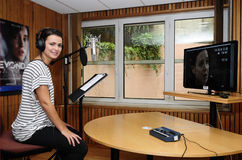 Voice Actress at Recording Studio - Video Games. Portuguese actress Joana Santos in studio, giving voice to Jodie Holmes, one of the two player characters in the Stock Image