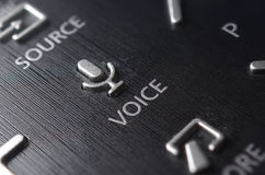 Voice button on the TV remote Stock Images