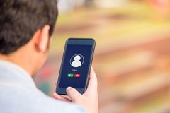 Voice call concept on phone screen. Voice call concept on the screen. Man holding smartphone doing voice call to someone stock photography