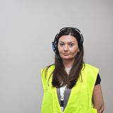 Voice Headset Worker. Woman With Wireless Picking System Control and Safety Vest Stock Photo