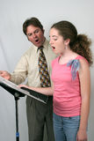 Voice Lesson Ahh Sound. A voice teacher instructing a student. They are making the Ahhh sound Royalty Free Stock Photo