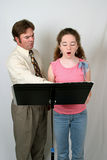 Voice Lesson Front View 2. A voice teacher instructing a student. Front vertical view Royalty Free Stock Photography
