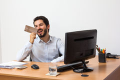 Voice messaging at work. Male worker sending voice message in his workstation Stock Photos