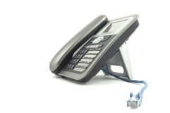 Voice over IP phone with blue ethernet cable Royalty Free Stock Photo