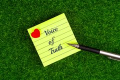 Voice of truth. In memo with heart shape and pen on grass background Stock Photography