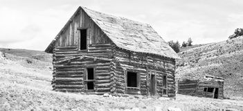 Voices From The Past. 1800`s cabin with a hayloft later added above in the high plains of south park colorado in pike national forest, shot in monochrome high royalty free stock photo
