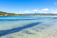 Voidokilia Beach, popular white sand and blue clear water beach in Messinia in Mediterranean area in shape of Greek letter omega, royalty free stock photo