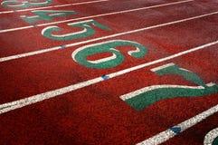Voie de course pour des nombres courants et des ruelles de concours photos libres de droits