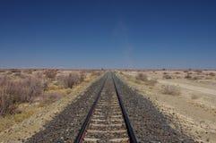 Voie ferroviaire dans le désert Images libres de droits