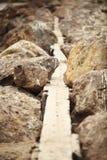 Voie rocheuse Symbole des difficultés sur le chemin Image stock