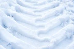 Voies dans la neige des roues photo stock