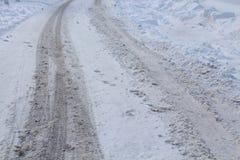 Voies de roue dans la neige Image libre de droits