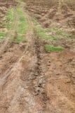 Voies de roue de la terre agricole Photos stock