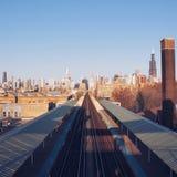 Voies de train dans la ville Photographie stock