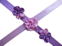 Voilet and pink bows,flowers,ribbons. Violet and pink bows-flowers on the crossed violet and pink satin ribbons Stock Photos