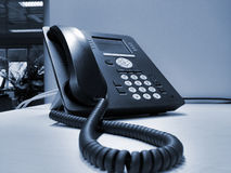 VoIP phone inside bank. Managerial VoIP phone on the office desk inside bank Royalty Free Stock Image