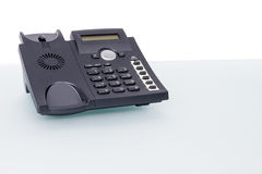 Voip phone on glass desk Stock Photo